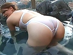 Slutty Yumi shows off her ass in the pool soaking wet