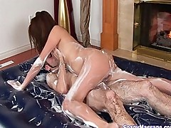 Hot Asian babe giving soapy cock massage