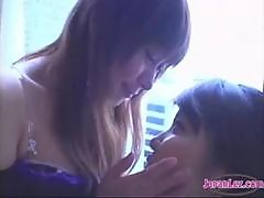 2 Asian Girls Kissing Passionately Sucking Tongues Spitting While Standing At The Window In The Hotel Room