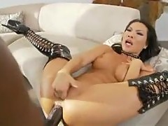 Asian in latex boots goes big and black