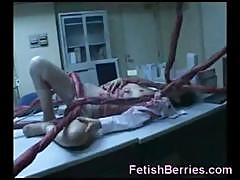 Young Brunette On The Table Gets Invaded By Mad Doctors Nasty Tentacle Monster