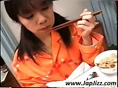 Asian nurse feed patient