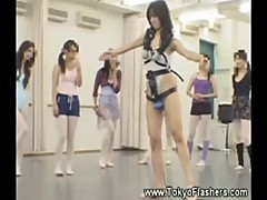 Petite asian stuffed with toys dances