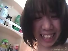 Japanese babe sucking cock in the bathroom