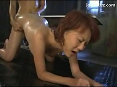 Redhead girl sucking strapon getting her pussy fucked oil