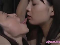 Slave Asian Girl Kissing Spitting With Mistress Fucked With Vibrator While Tied To Cross In The Dungeon